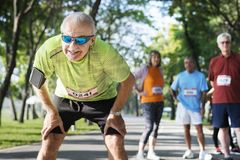 Exhausted senior runner at the park royalty free stock photography