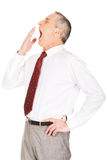 Exhausted sleepy mature businessman yawning Stock Photography