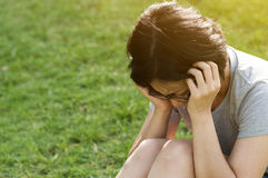 Exhausted, streesed  Illness and tired concept. Asian glasses woman having headache while workout at the park Stock Photo