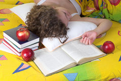 Exhausted student. Is lying near books in bed royalty free stock photos