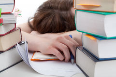 Exhausted student behind a books Royalty Free Stock Photo