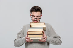 Exhausted student in glasses holding books Royalty Free Stock Images