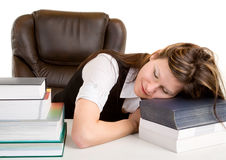 Exhausted Student Sleeping on Her Books stock images
