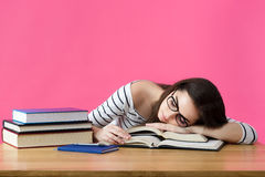 Exhausted student sleeping at her desk Stock Photo