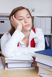 Exhausted student sleeping over books Stock Images