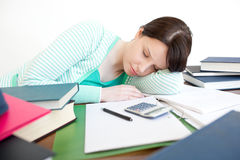 Exhausted student sleeping while studying Stock Photography