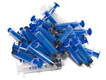 Exhausted syringes stock images