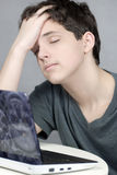 Exhausted Teen Works On Computer Royalty Free Stock Photo