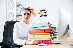 Exhausted tired businesswoman sitting at the office desk Royalty Free Stock Photos