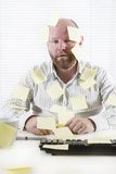 Exhausted Office Worker with Notes Everywhere Stock Images