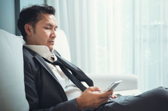 Exhausted, tired from overworked concepts. Businessman in grey s Royalty Free Stock Images