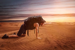 Exhausted Wanderer. Thirsty man in the desert Stock Photos