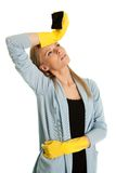 Exhausted woman after cleaning routine Royalty Free Stock Image