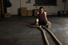 Exhausted woman in a cross-training gym. Portrait of a pretty young Latin woman looking exhausted and defeated in a cross-training gym Stock Photo