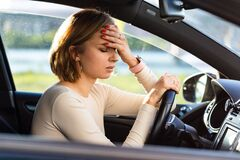 Free Exhausted Woman Driver Feeling Headache, Sitting Inside Her Car, Stop After Driving Car In Traffic Jam Royalty Free Stock Image - 188984566