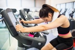 Exhausted woman on the exercise bike Stock Photography