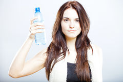 Exhausted woman after fitness with towel and water bottle Stock Photography