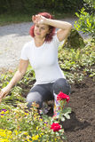 Exhausted woman gardener Stock Photography