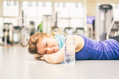 Exhausted woman in a gym Royalty Free Stock Images