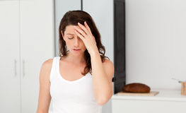 Exhausted woman having a headache in her bathroom Royalty Free Stock Image