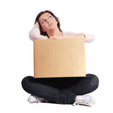 Exhausted woman holding moving box Royalty Free Stock Image