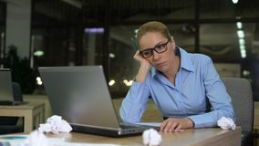 Exhausted woman lacking business ideas, working extra hours in office, burnout. Stock footage stock video footage
