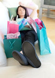 Exhausted woman relaxing after shopping Stock Photography