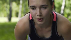 Exhausted woman runner breathes heavily, tired sportswoman outdoors slow motion. Stock footage stock video