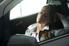 Exhausted woman sleeping in a car Stock Photo