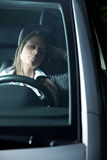 Exhausted woman sleeping in a car Stock Photography