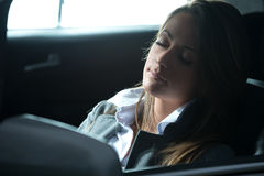 Exhausted woman sleeping in a car Royalty Free Stock Photography