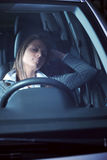 Exhausted woman sleeping in a car Royalty Free Stock Image