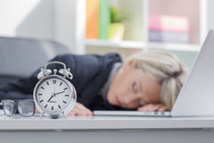 Exhausted woman sleeping in front of computer royalty free stock photo