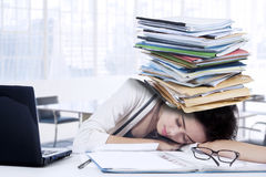 Exhausted woman sleeping on the table Royalty Free Stock Images