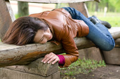 Exhausted woman sleeping on a wooden bench Stock Images