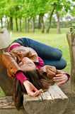 Exhausted woman sleeping on a wooden bench Stock Image