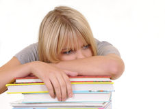 Exhausted woman on a stack of books Royalty Free Stock Image