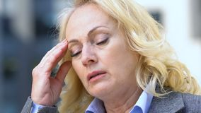 Exhausted woman suffering headache, worrying about life troubles, dismissal. Stock footage stock footage
