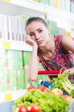 Exhausted woman at supermarket Royalty Free Stock Image