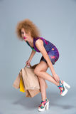 Exhausted woman touching her hurting legs on shopping Royalty Free Stock Photography