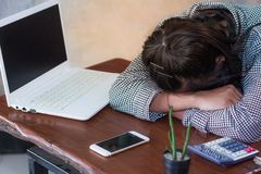 Exhausted women sleeping at workplace after hard working day stock photo