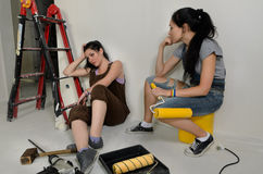 Exhausted women taking a break from renovating Stock Photography
