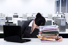 Exhausted worker napping over documents Stock Image