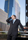 Exhausted worried businessman outdoors in stress and depression Royalty Free Stock Photography