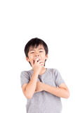 Exhausted young boy yawning Stock Photos