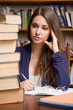 Exhausted young brunette student. Stock Image