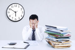 Exhausted young businessman stock images