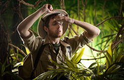Exhausted young explorer in the jungle Stock Photo