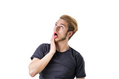 Exhausted young  man looking up with open mouth Royalty Free Stock Images