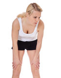 Exhausted young woman in sports wear Stock Photography